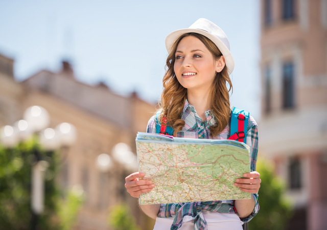 Young female tourist with map