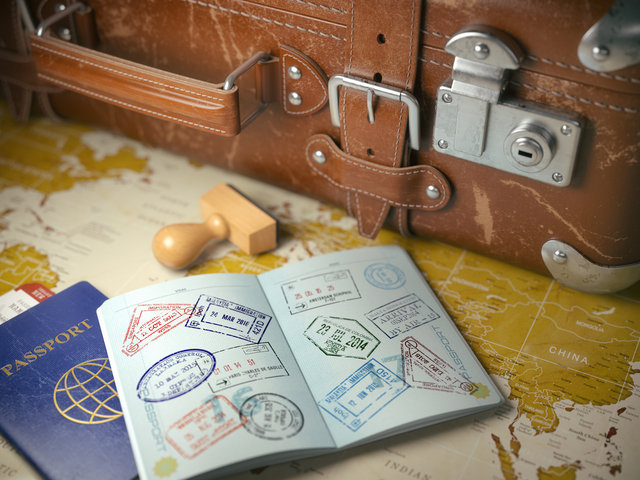 Travel or turism concept.  Old  suitcase  with opened passport w